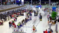 HD:Crowd traveller waitnig in row to check-in at the Airport.