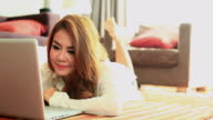 HD:Cute asian female playing notebook.(Dolly shot)
