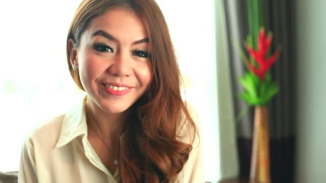 HD:Cute asian female talking to webcam.