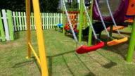 HD:Empty swing at playground.