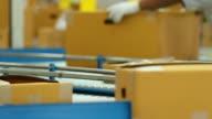 HD:Goods On Conveyor Belt In Distribution Warehouse.