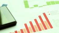 HD:Graphs, eyeglasses, business table.