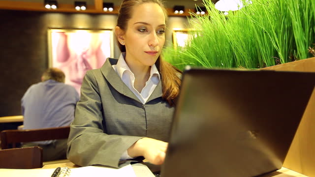 HD:Hand of businesswoman working with her labtop in a restaurant.