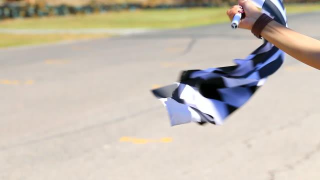HD:Hand of woman waving race flag.