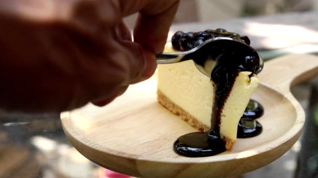 HD:Hand taking a piece of cake ,blueberry cheesecake