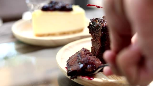 HD:Hand taking a piece of cake ,chocolate cake