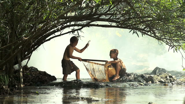 HD:Happy moment for kids enjoyed fishing in waterfall,Thailand