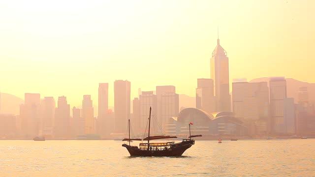 HD:Hong kong traditional sailing junk silhouette scene.