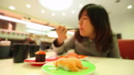 HD:Japanese woman eating sushi in the japanese restaurant.