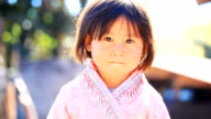 HD:Little girl with thai traditional clothing style.