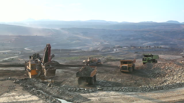 HD:Loading of iron ore on very big dump-body truck.