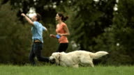 HD:Loving Couple Running With Their Dog