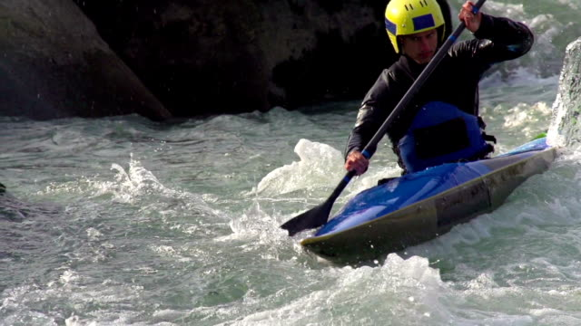 HD:Male Kayaker Boating in Whitewater