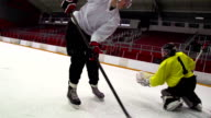 HD:M.S.Shot of Hockey Player Shooting at Goal
