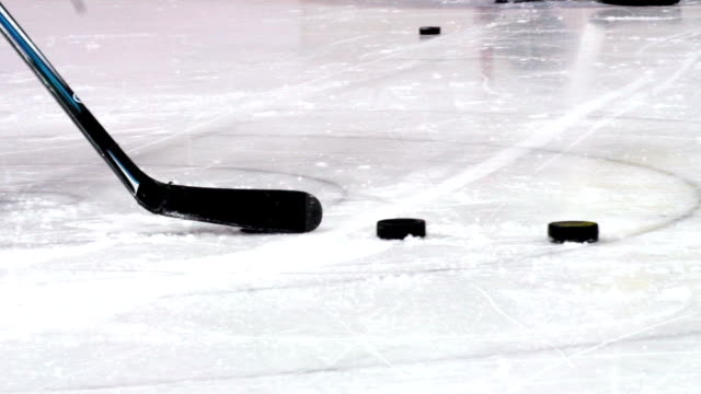 HD:M.S.Shot of Hockey Player Shooting at Goal