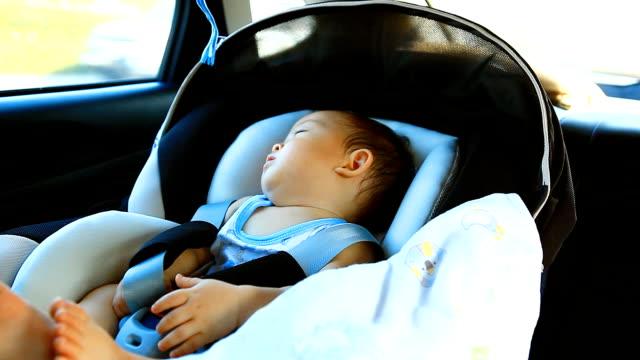 HD:Portrait of a little boy sleeping in the car.
