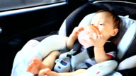 HD:Portrait of little baby in safety carseat.