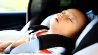 HD:Portrait of little baby  sleeping in safety carseat.