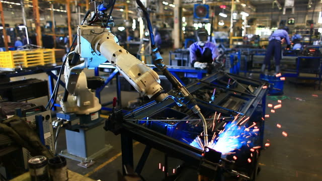 HD:Robot arm welding machine working in factories.