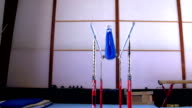 HD:Shot of Gymnast Performing Routine on Parallel Bars