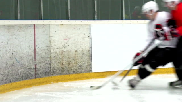 HD:Shot of Two Ice Hockey Players Duelling by the Fence