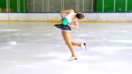 HD:Shot of Young Woman at Figure Skating