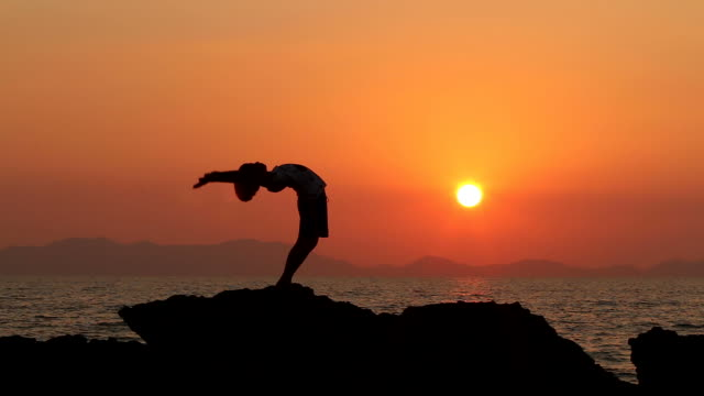 HD:Silhouette of young girl exercise YOGA(Bridge pose modify)