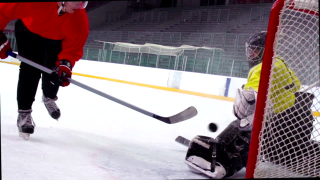 HD:Slo-Mo-Shot of Ice Hockey Player Practicing Penalty Shot