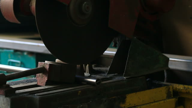 HD:Sparks while grinding steel pipe.