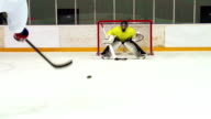 HD:Super Slo-Mo Shot of Young Ice Hockey Players Practicing