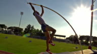 HD:Super Slo-Mo Shot of Young Man at Pole Vault