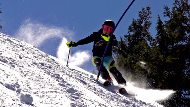 HD:Super-Slo-Mo: Professional Female Skier Practicing Slalom