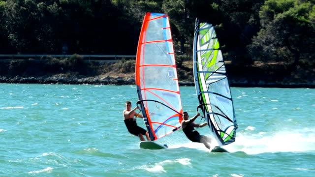 HD:Two windsurfers racing at regatta