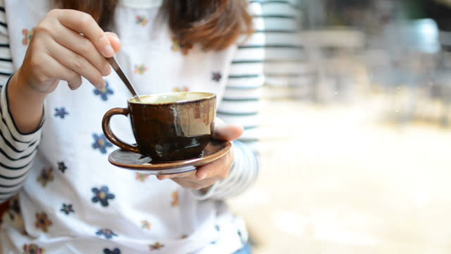 HD:Woman stirring coffee for relax time
