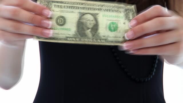 HD:Woman stretches a dollar