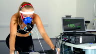 HD:Women Performing Pulse Trace and VO2Test on the Indoor Bicycle