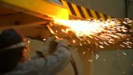 HD:Worker using torch cutter to cut through metal