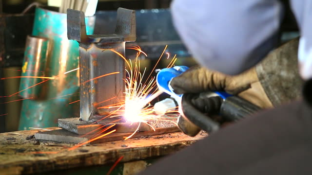 HD:Worker using welding machine on his work.