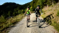 HD:Young couple cycling on the country road