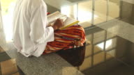HD:Young man reading the koran at the mosque.