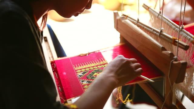 HD:Young woman making a carpet.