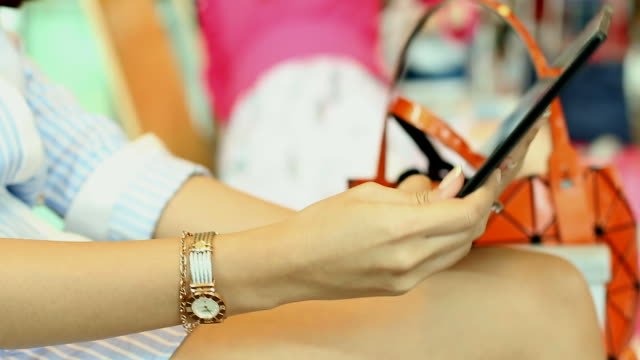 HD:Young woman playing tablet on her room.