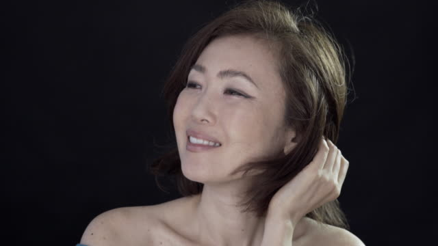 Head and shoulder beauty clips of a Japanese lady.