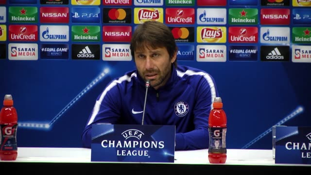 Head coach Antonio Conte and goalkeeper Thibaut Courtois of Chelsea attend a press conference at Olympic stadium on November 21 2017 in Baku...