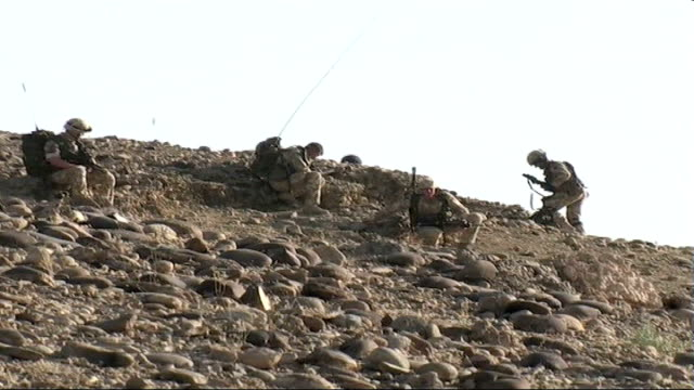 Head of NATO's force in Afghanistan says operation against Taliban successful DATE British troops along on rocky terrain