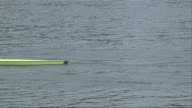 Head of the River Boat Race 2015 ENGLAND London Mortlake EXT Rowing crew putting their boat in the river Crew getting into boat Crew in boat as...