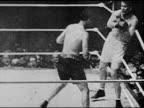 BOXING Headlines 'Tunney Win' SLO MO Former champion Jack Dempsey boxing in ring fight w/ Heavyweight Champion Gene Tunney Dempsey knocking Tunney...