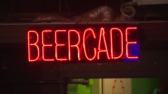 Headquarters Bar in downtown Chicago combines the love of craft beer and arcade games Beercade Neon Sign on October 10 2013 in Chicago Illinois