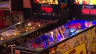 WGN Headquarters Bar in downtown Chicago combines the love of craft beer and arcade games The Simpsons And Twilight Zone Pinball Machines on October...