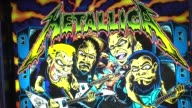Headquarters Bar in downtown Chicago combines the love of craft beer and arcade games Metallica Pinball Machine on October 10 2013 in Chicago Illinois